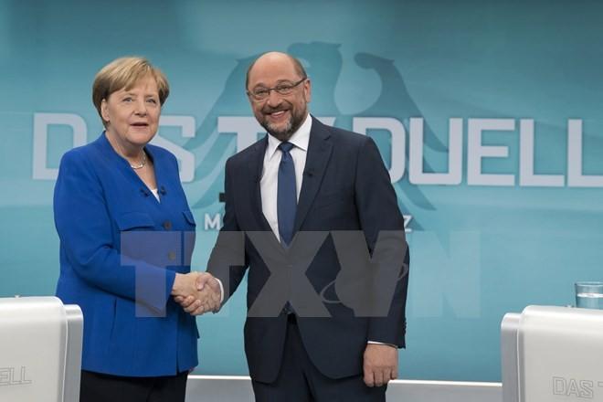 Allemagne: La CDU de Merkel pour une grande coalition avec le SPD - ảnh 1