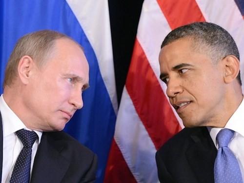 Pemimpin Rusia dan AS melakukan pembicaraan telepon tentang masalah-masalah panas di dunia - ảnh 1
