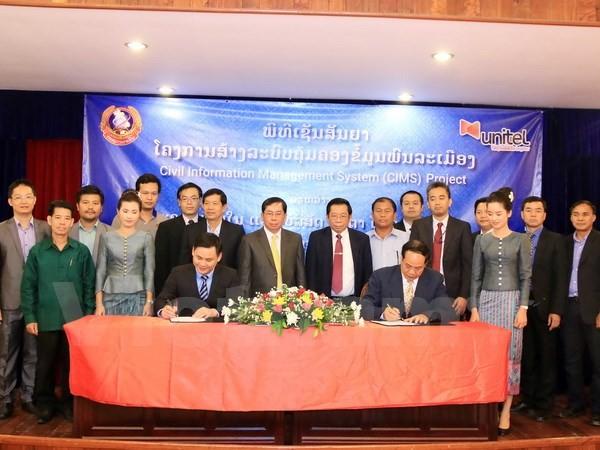 Usaha patungan telekomunikasi Laos-Vietnam membantu Laos membangun sistem manajemen kependudukan - ảnh 1
