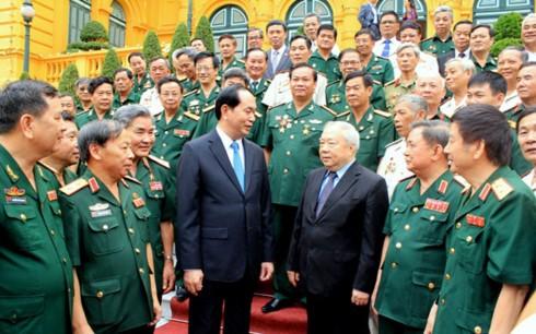 Presiden Vietnam, Tran Dai Quang melakukan pertemuan dengan para mantan prajurit sukarela di Kamboja - ảnh 1