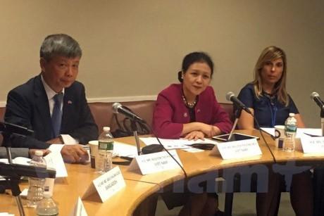 """Vietnam memimpin simposium internasional: """"Teknologi informasi – komunikasi dan pemberantasan kemiskinan"""" - ảnh 1"""