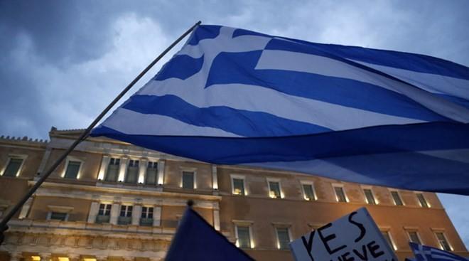 """IMF mengesahkan paket talangan """"tergantung"""" untuk Yunani - ảnh 1"""