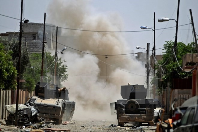 IS akan kalah oleh operasi-operasi militer pimpinan AS - ảnh 1