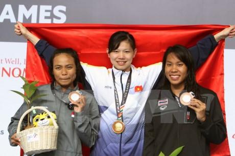 SEA GAME 29: Menggondol lagi 4 medali emas, kontingen olahraga Vietnam menduduki posisi ketiga - ảnh 1