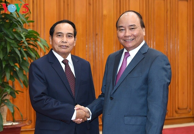 Vietnam bersedia berbagi pengalamaan perkembangan dengan Laos - ảnh 1