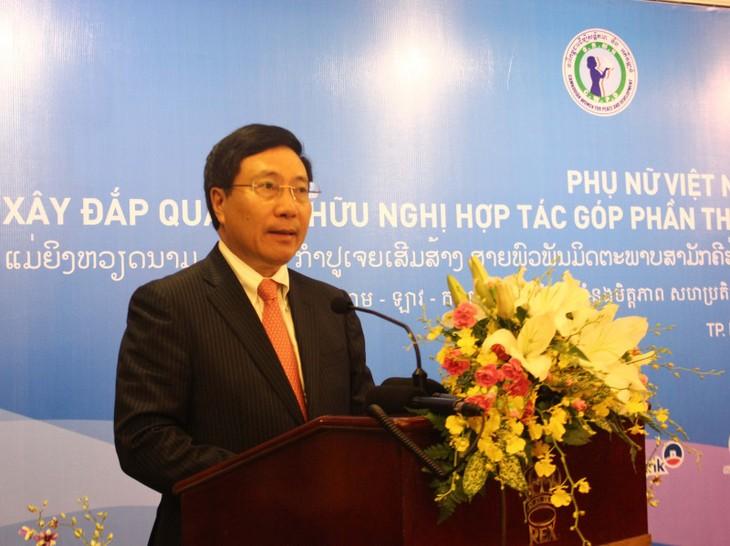 Deputi PM Vietnam, Pham Binh Minh menghadiri Forum Wanita Vietnam-Laos-Kamboja - ảnh 1