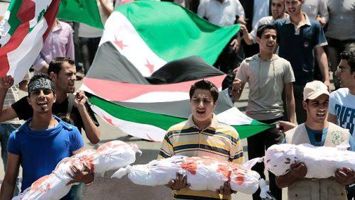 Вьетнам осудил недавнюю трагедию в сирийском городке Хула - ảnh 1