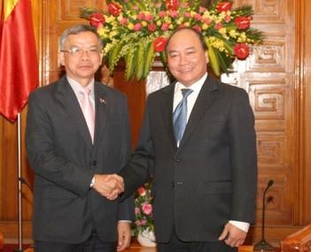 Вице-премьер Вьетнама принял министра общественных работ и транспорта Лаоса - ảnh 1
