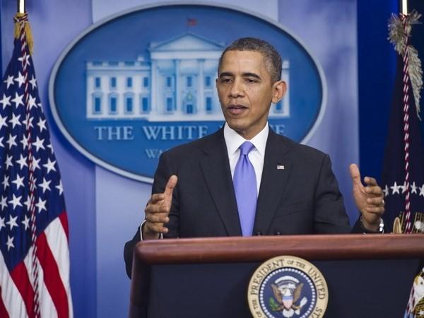 Обама надеется на достижение страной новых сдвигов в 2014 году - ảnh 1