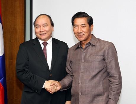 Phó Thủ tướng Nguyễn Xuân Phúc tiếp Phó Thủ tướng Cộng hòa Dân chủ nhân dân Lào  - ảnh 1