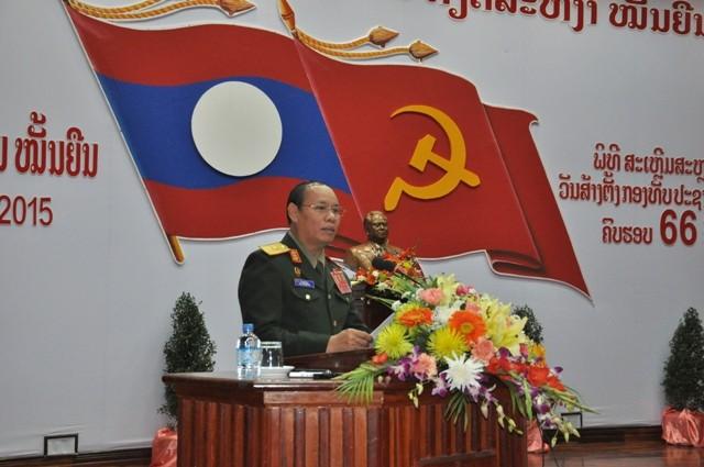 Mít tinh kỷ niệm 66 năm ngày thành lập Quân đội nhân dân Lào - ảnh 1