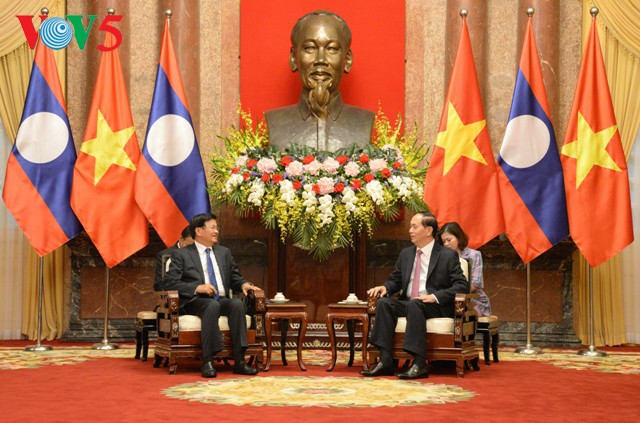 Chủ tịch nước Trần Đại Quang tiếp Thủ tướng Lào Thongloun Sisoulith - ảnh 1