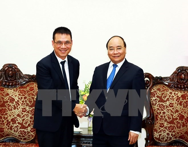 PM asks Thailand's SCG group to expand investment in Vietnam - ảnh 1