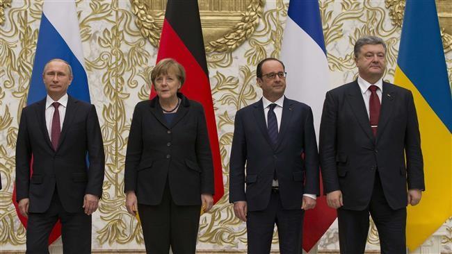ผู้นำรัสเซีย เยอรมนี และฝรั่งเศส แสวงหามาตรการทางการเมืองให้แก่วิกฤติยูเครน - ảnh 1