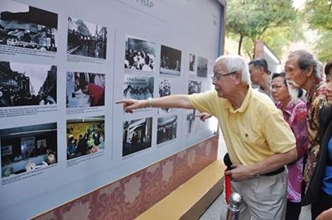 Inauguran exposición fotográfica sobre vietnamitas residentes en Francia - ảnh 1