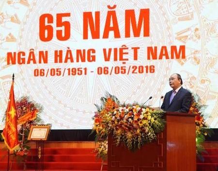 Primer ministro vietnamita honra contribuciones del Banco Estatal   - ảnh 1