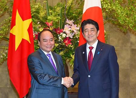 Finaliza el primer ministro vietnamita su visita a Japón y asistencia a la Cumbre ampliada del G7 - ảnh 2