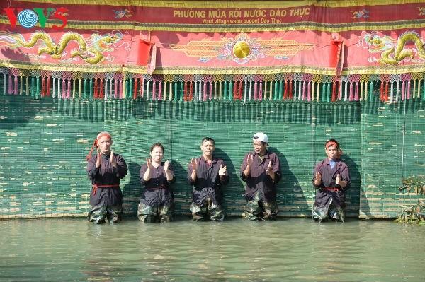 La aldea Dao Thuc y su original arte de las marionetas de agua  - ảnh 1