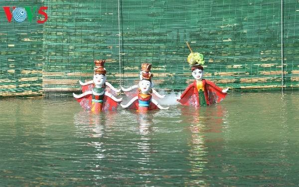 La aldea Dao Thuc y su original arte de las marionetas de agua  - ảnh 2