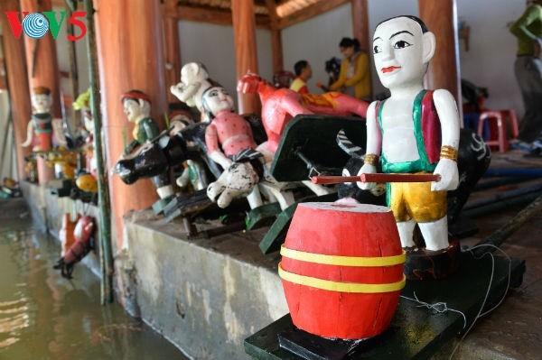 La aldea Dao Thuc y su original arte de las marionetas de agua  - ảnh 3