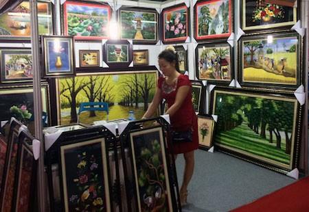 Historia de la aldea de los bordados de Quat Dong en Hanoi  - ảnh 2