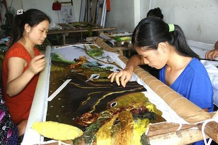Historia de la aldea de los bordados de Quat Dong en Hanoi  - ảnh 1