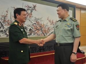 Memperkuat kerjasama antara tentara Vietnam dan Tiongkok - ảnh 1