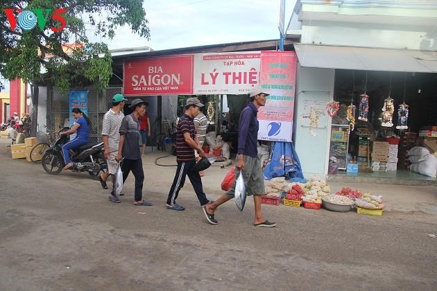 Kehidupan sehari hari di kabupaten pulau Ly Son - ảnh 17