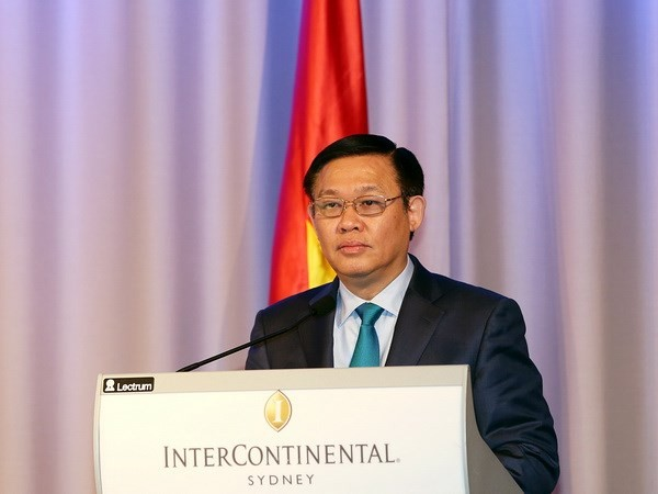 Deputi PM Vuong Dinh Hue melakukan temu kerja dengan Menteri Luar Negeri Australia - ảnh 1