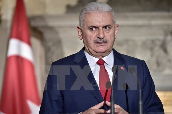 PM Republik Turki, Binali Yildirim memulai kunjungan resmi di Vietnam - ảnh 1