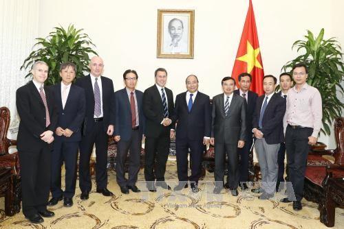 PM Nguyen Xuan Phuc menerima pemimpin Grup ExxonMobil (AS) dan mantan Walikota Osan, Republik Korea - ảnh 1