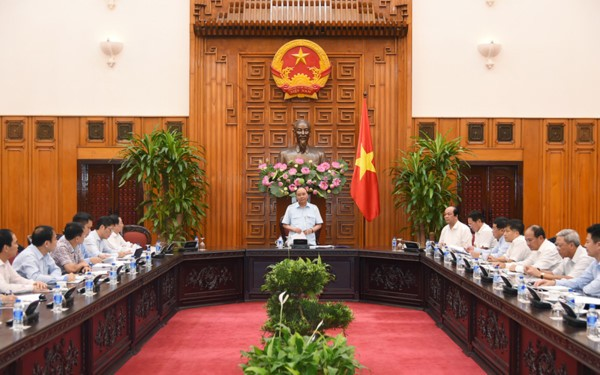 PM Nguyen Xuan Phuc melakukan temu kerja dengan pemimpin Grup Permigasan  Nasional Vietnam (PVN) - ảnh 1