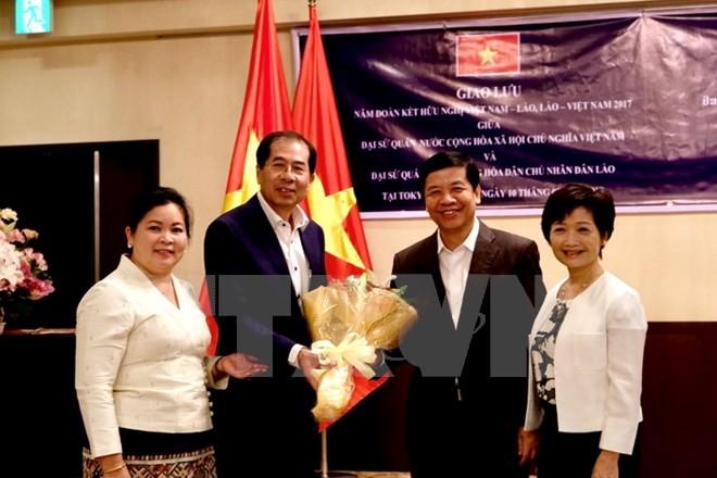 Дружественная встреча между Вьетнамом и Лаосом в Японии - ảnh 1