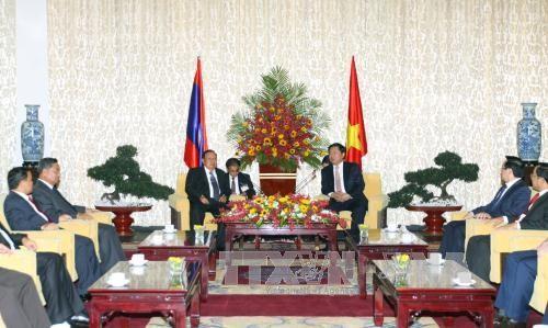 老挝人民革命党中央总书记、国家主席本扬·沃拉吉访问胡志明市 - ảnh 1