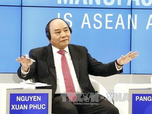 阮春福圆满结束出席世界经济论坛第47届年会行程 - ảnh 1