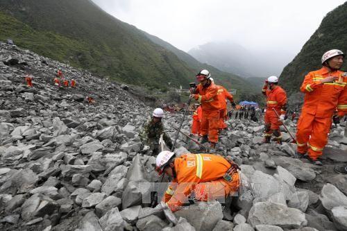 中国山体垮塌:伤亡人数继续增加 - ảnh 1