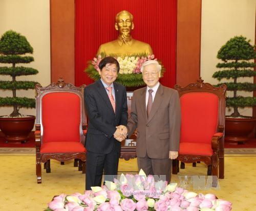 阮富仲会见新加坡执政党人民行动党主席许文远 - ảnh 1