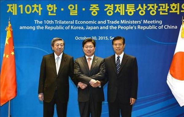 日中韩承诺推动全球自由贸易 - ảnh 1