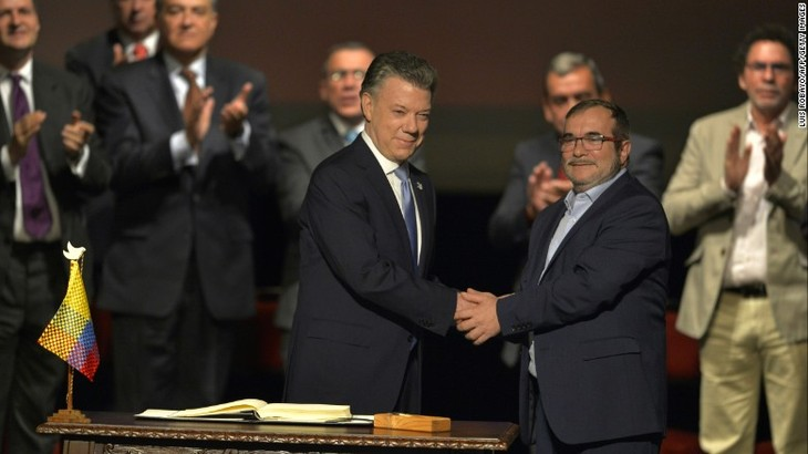 Colombia, FARC sign revised peace deal  - ảnh 1