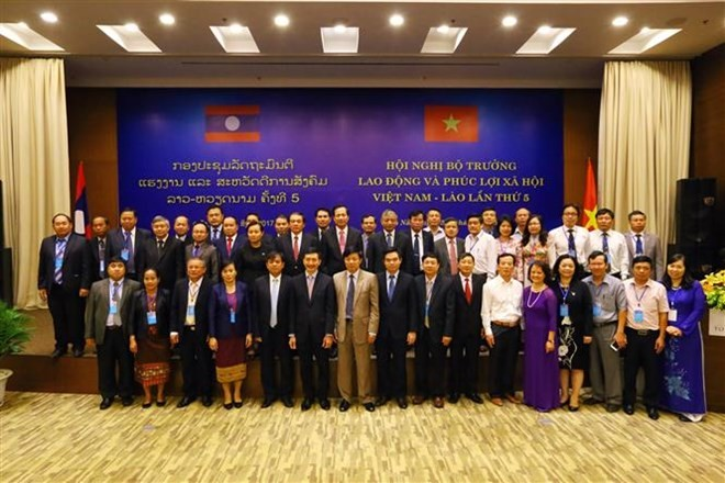 Vietnam, Laos boosts cooperation in labor, social affairs  - ảnh 1