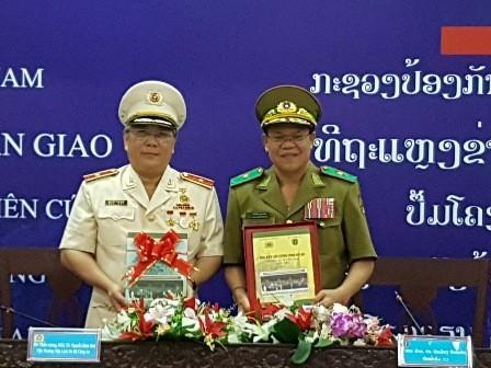 Tăng cường hợp tác khoa học lịch sử giữa hai Bộ Công an Việt Nam và Lào  - ảnh 1