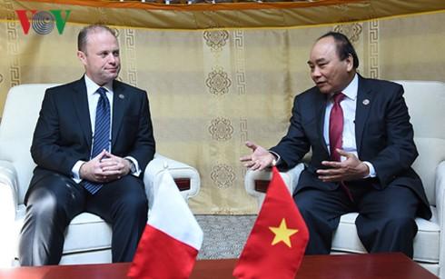 Thủ tướng Nguyễn Xuân Phúc tiếp xúc song phương bên lề Hội nghị Cấp cao ASEM 11  - ảnh 5