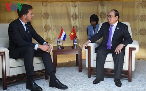 Thủ tướng Nguyễn Xuân Phúc tiếp xúc song phương bên lề Hội nghị Cấp cao ASEM 11  - ảnh 7