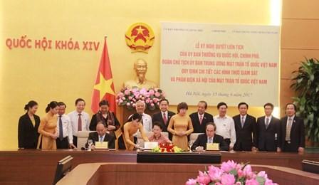 Ủy ban Thường vụ Quốc hội, Chính phủ,  Ủy ban TW Mặt trận Tổ quốc Việt Nam ký nghị quyết liên tịch - ảnh 1