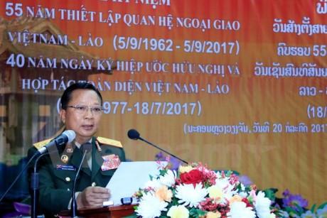 Bộ Quốc phòng Lào mít tinh trọng thể kỷ niệm các ngày lễ lớn của 2 nước - ảnh 1