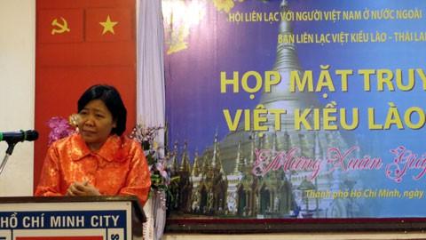 การพบปะสังสรรค์ชาวเวียดนามที่พำนักอาศัยในประเทศลาวและประเทศไทยในโอกาสตรุษเต๊ดประเพณีเวียดนาม 2014 - ảnh 1