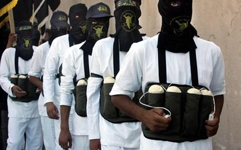 มีชาวอิรักกว่า ๑๐๐ คนเสียชีวิตจากการวางระเบิดพลีชีพของไอเอส - ảnh 1