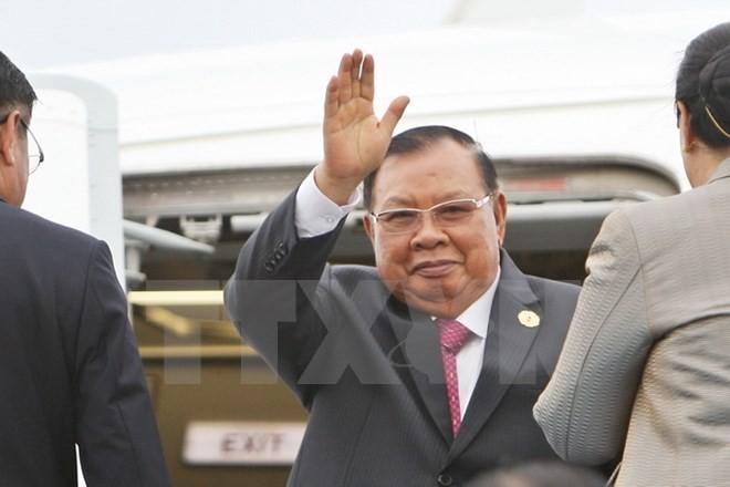 Tổng Bí thư, Chủ tịch nước Lào bắt đầu thăm hữu nghị chính thức Việt Nam  - ảnh 1