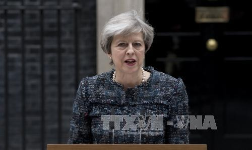 អង់គ្លេស៖នាយករដ្ឋមន្រ្តីលោកស្រី Theresa May រក្សាលំដាប់ថ្នាក់ទី១ក្នុងការ ស្ទង់មតិ - ảnh 1