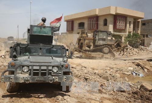 កងកម្លាំងរដ្ឋាភិបាលអ៊ីរ៉ាក់រំដោះតំបន់ជុំវិញភាគពាយព្យក្រុង Mosul - ảnh 1